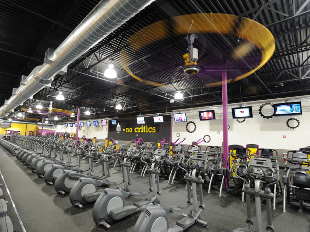 Image shows the inside of a Planet Fitness Gym in the United States