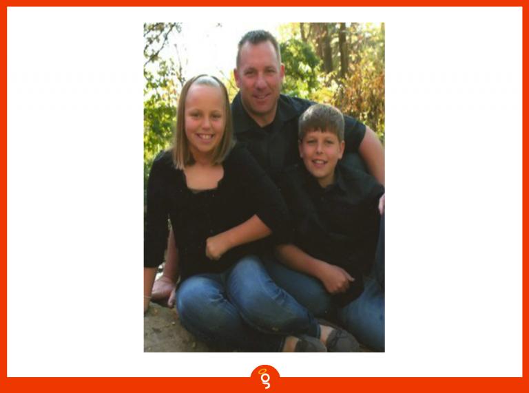 Scott Dennis sitting with his two children