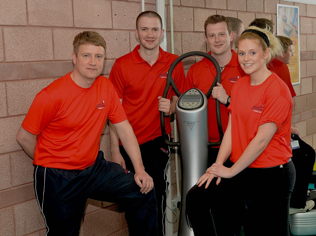 Borders Sport and Leisure gym staff next to Power Plate vibration training machine