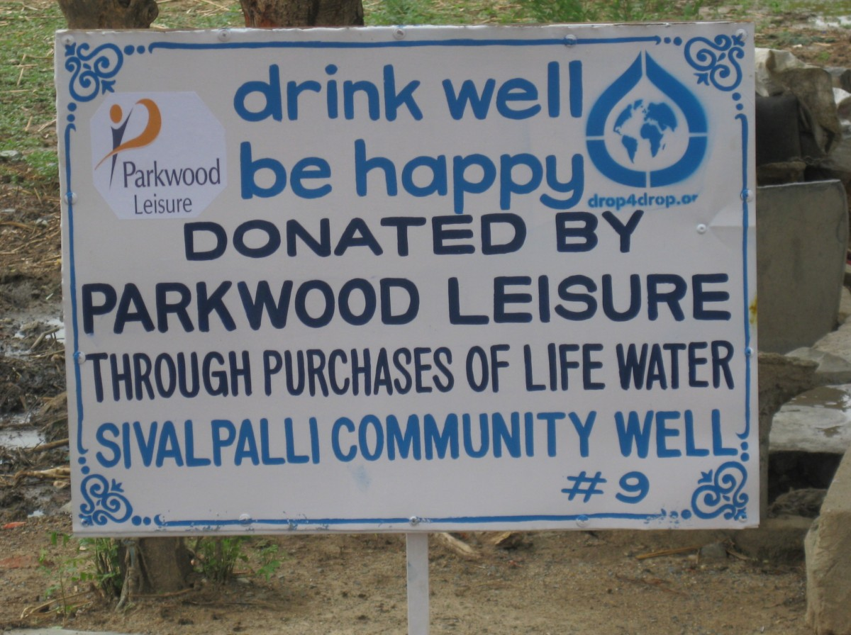 Sign showing the words 'drink well, be happy, well donated by Parkwood Leisure