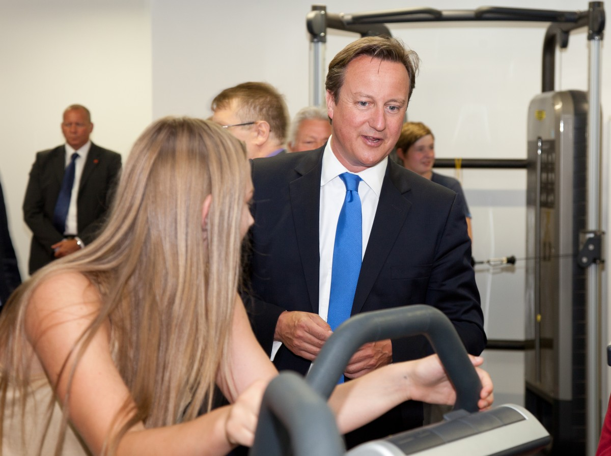 Prime Minister, David Cameron talking to a young girl in the new gym on his official visit to Wigan Youth Zone
