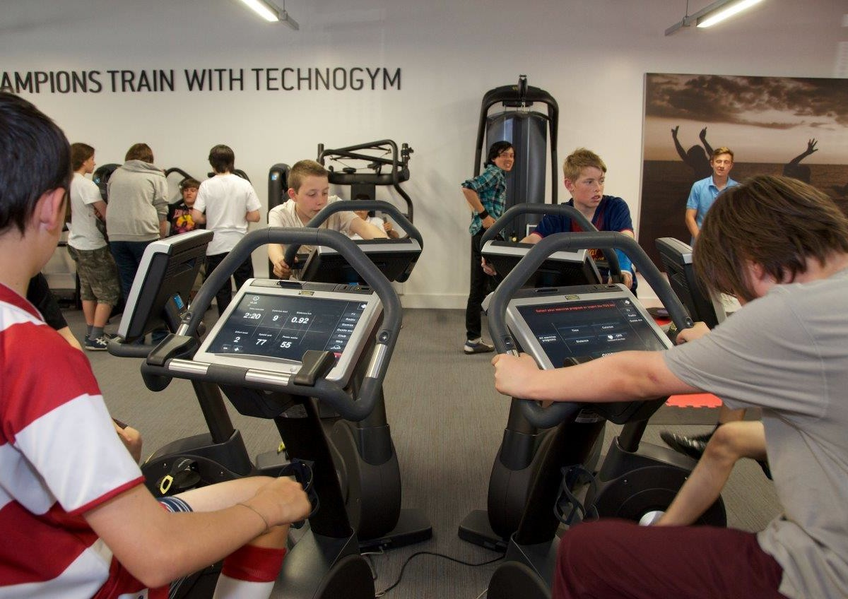 Group of four boys using Technogym bikes in the new Wigan Youth Zone gym