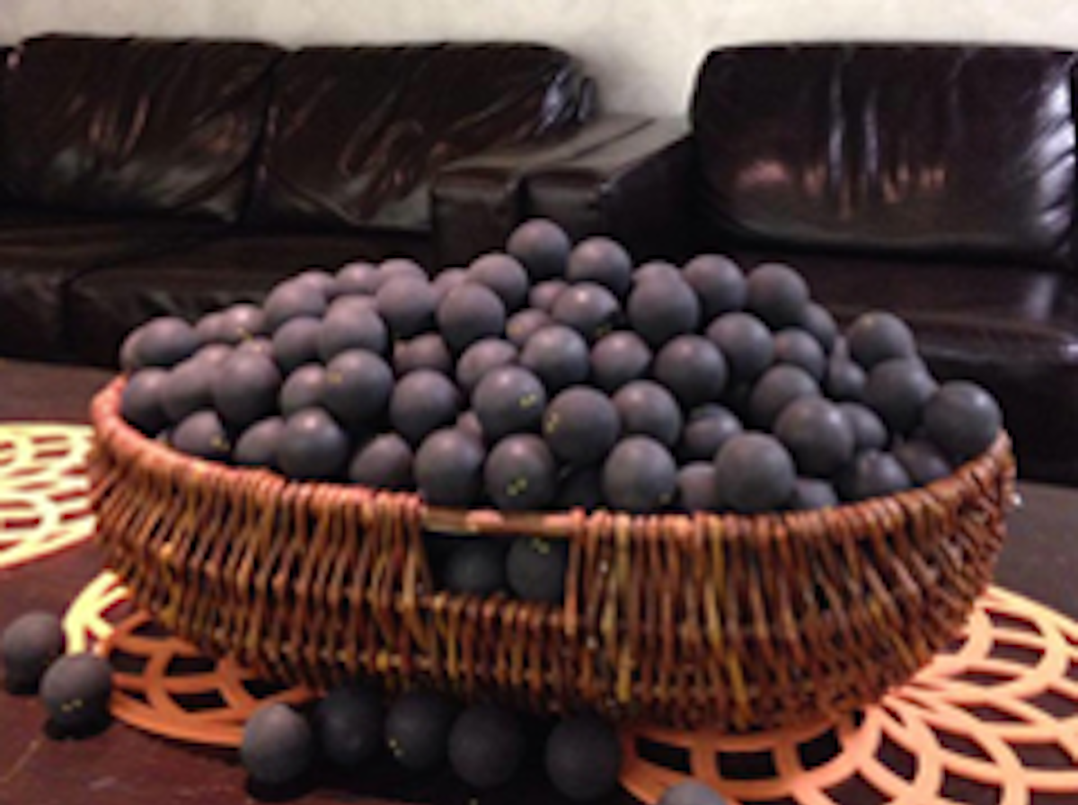 PIcture showing large basket of used squash balls