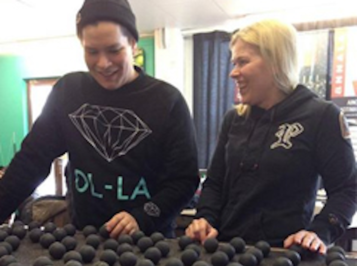 Anna and Rounaja, two staff members are sorting the used squash balls