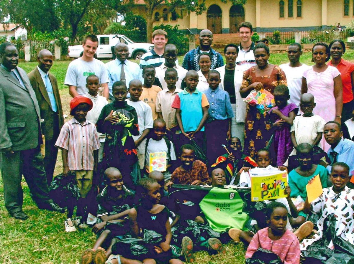 Group of Ugandan children with visiting staff from UK-based Fitness Express who are actively sponsoring 30 children