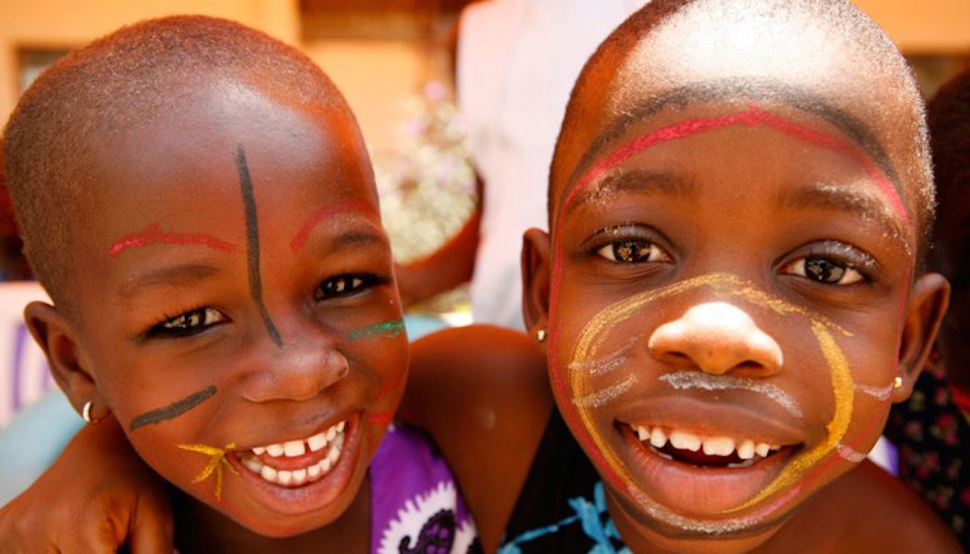 Beautiful image of a young boy and girl (possibly brother and sister) with big smiles