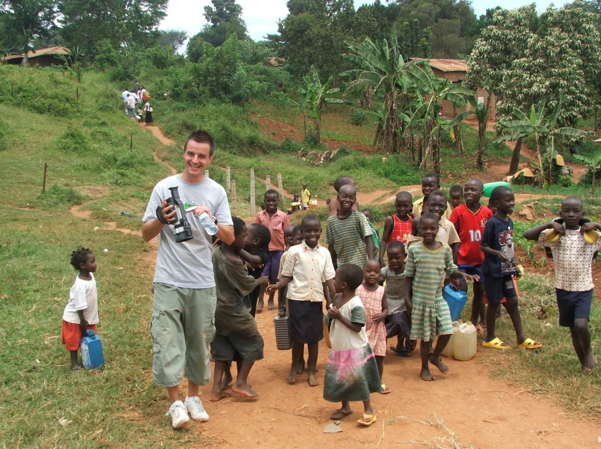 Fitness Express staff member with a group of young Ugandan children taken during visit to see the impact of their sponsorship with Compassion charity