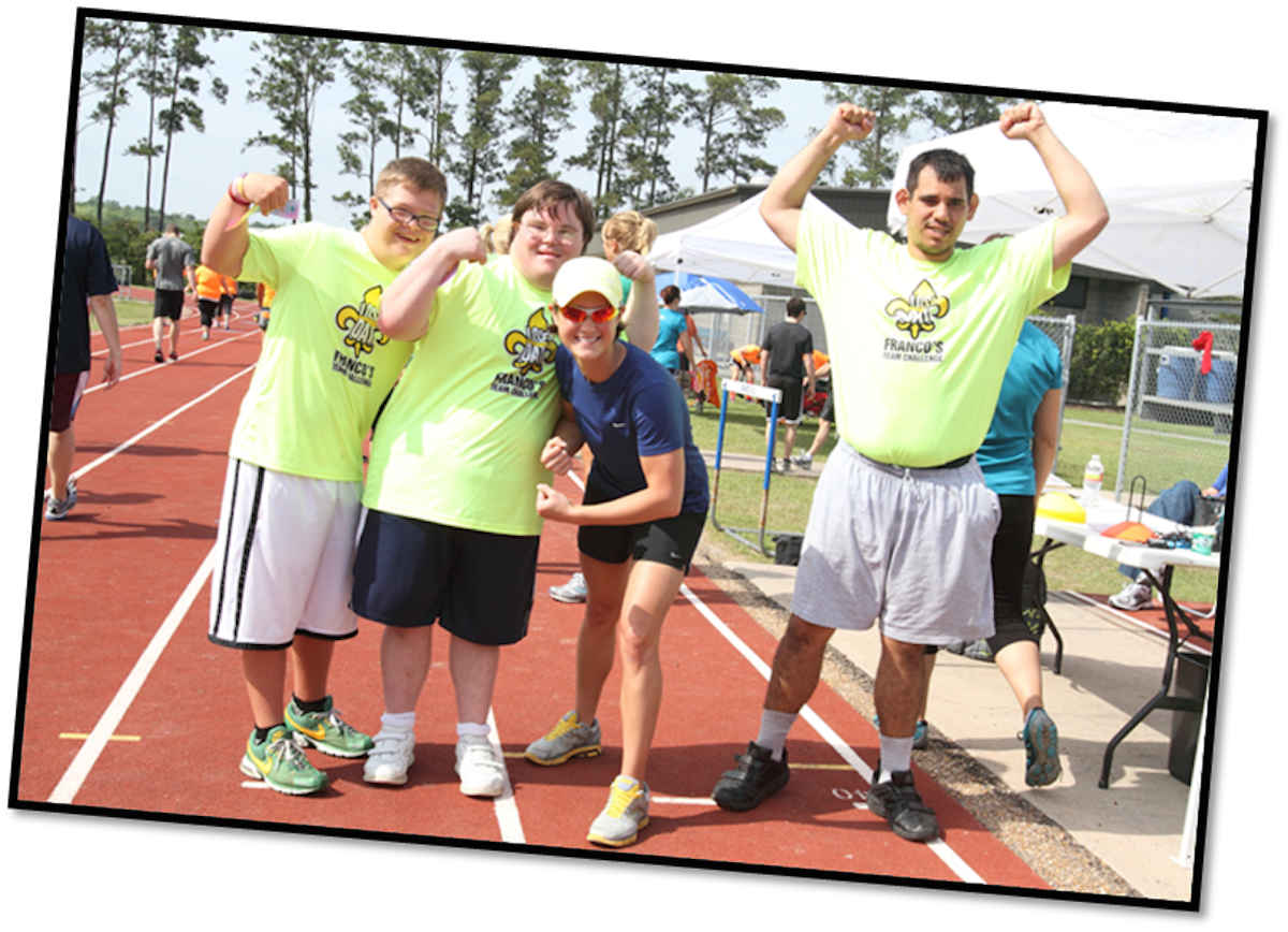 Four runners with special needs raising their arms at the Franco's health and fitness club in Louisiana USA