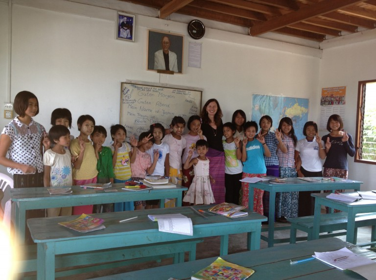 Jasmin Kirstein, founder of My Sportlady club in Munich stands with staff and children from an orphanage in Myanmar – Gymtopia.org
