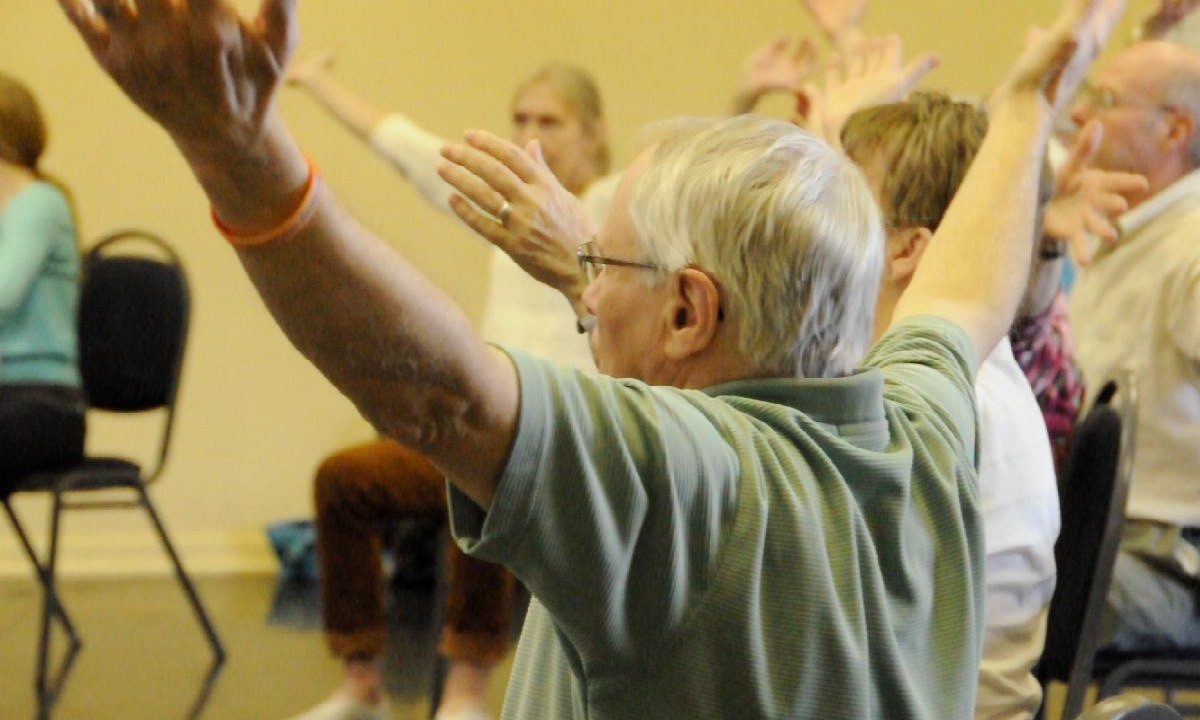A group of men and women taking part in the Dancing Parkinson's YYC programme taught by Decidedly Jazz Danceworks using a Dance Education model from the University of Calgary, Alberta, Canada - Gymtopia.org