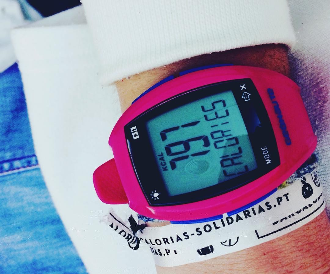 Close up of a activity tracker watch showing 791 calories expended during exercise workout