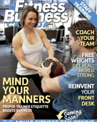 Pictture shows female personal trainer helping a male client in the gym
